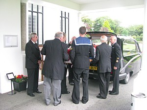 Pall bearers at Dave Ellis's funeral including his son Steve and SDU1 members