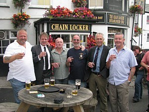 Tim Hadley, Sandy Sanders, Tim Sizer, Rob Hoole, Cris Ballinger and Tug Wilson raise a glass in Dave Ellis's memory