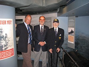 David Ouvry, Rob Hoole and Noel Cashford with John Ouvry's mine on board HMS Belfast