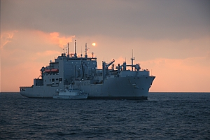 HMS Blyth fuels alongside USNS Lewis and Clark as the sun sets on another day in the Gulf