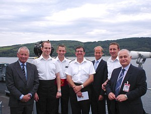 Commodore Hudson flanked by other former COs of HMS Cottesmore including MCDOA members David Hilton (far left) and Chris Thompson (far right) the evening before her joint-decommissioning ceremony with Brecon and Dulverton at Faslane on 14 July 2005