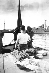Diving tender in Haifa 1947 - HMS Chevron in background