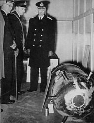 King George VI with Capt Riley (SMD), Lt Cdr Ouvry and his mine at HMS Vernon 19 Dec 1939